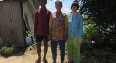 Mrs. Sin Synoeurn age 39 years old with her two kids. Mrs. Sin Sysoeurn is a housewife and her husband is a fisherman who earns 5$ per day to support the family.